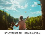 woman standing on cliff and... | Shutterstock . vector #553632463