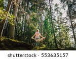 woman hiking in woods  warm... | Shutterstock . vector #553635157