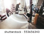 hairdresser tools on counter... | Shutterstock . vector #553656343