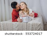 loving couple decorating... | Shutterstock . vector #553724017