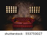 leather couch in a dark room on ... | Shutterstock . vector #553753027