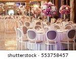 grey chairs stand around dinner ... | Shutterstock . vector #553758457