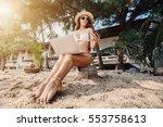woman sitting on sea shore...   Shutterstock . vector #553758613