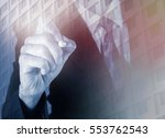 business man holding pen with... | Shutterstock . vector #553762543