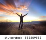 man with arms raised  looking... | Shutterstock . vector #553809553