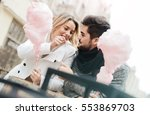 beautiful young smiling couple... | Shutterstock . vector #553869703
