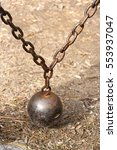 Small photo of Old counterweight ball and chain still in use on gate.