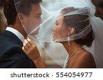 portrait of bride and groom... | Shutterstock . vector #554054977