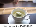 tea bag of green tea | Shutterstock . vector #554154013