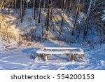 bench in winter forest   Shutterstock . vector #554200153