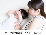 mother and her baby lying on a...   Shutterstock . vector #554216983