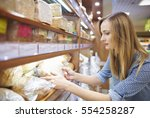 woman holding loaf of fresh... | Shutterstock . vector #554258287
