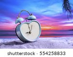 Small photo of last minute to count down for travel metaphor by old retro clock on sunset beach ,abstract background to time for summer vacation travel concept.
