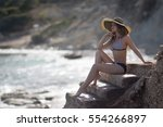the girl sitting on a ladder... | Shutterstock . vector #554266897
