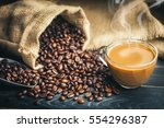 coffee cup and coffee beans... | Shutterstock . vector #554296387