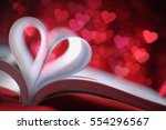 pages of a book curved into a... | Shutterstock . vector #554296567