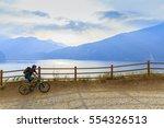 mountain biking on lake garda ... | Shutterstock . vector #554326513