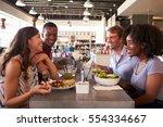 friends enjoying lunch date in... | Shutterstock . vector #554334667