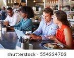 group enjoying business lunch... | Shutterstock . vector #554334703