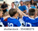 young soccer players holding... | Shutterstock . vector #554380273