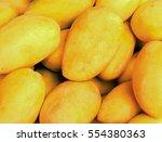 bunch of yellow mango on shop's ... | Shutterstock . vector #554380363