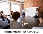 businesspeople at whiteboard... | Shutterstock . vector #554390113