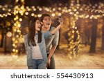 happy asian couple in love... | Shutterstock . vector #554430913