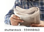 man reading newspaper on table | Shutterstock . vector #554448463