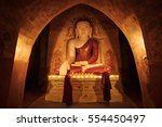 little monk praying with... | Shutterstock . vector #554450497