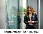 teenager looking to phone phone ... | Shutterstock . vector #554480503