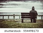 man sitting on bench... | Shutterstock . vector #554498173