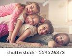 large group of children lying... | Shutterstock . vector #554526373