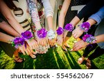 wrist corsage  group of woman | Shutterstock . vector #554562067