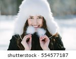 winter portrait of beautiful... | Shutterstock . vector #554577187