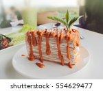 thai tea crape cake on white... | Shutterstock . vector #554629477