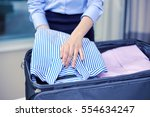 business  trip  luggage and... | Shutterstock . vector #554634247