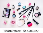 makeup items on a pastel... | Shutterstock . vector #554683327