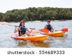 two kayak in a lake mother and... | Shutterstock . vector #554689333