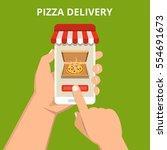 order pizza online. hand... | Shutterstock .eps vector #554691673