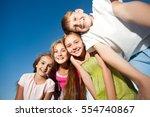 four happy beautiful children...   Shutterstock . vector #554740867