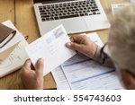 senior adult reading letter... | Shutterstock . vector #554743603