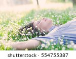 beautiful young woman laying on ... | Shutterstock . vector #554755387