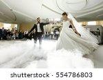 bride whirls to groom dancing... | Shutterstock . vector #554786803