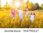 four happy beautiful children... | Shutterstock . vector #554790217