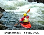 A Whitewater Kayaker Waiting T...