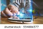 business man working on virtual ... | Shutterstock . vector #554886577