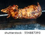 whole lamb baked on a spit. | Shutterstock . vector #554887393