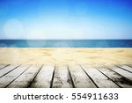 sandy beach with wooden table... | Shutterstock . vector #554911633