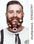funny bearded man with hearts... | Shutterstock . vector #555020797
