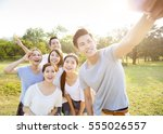 happy young group taking selfie ... | Shutterstock . vector #555026557